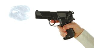The hand takes a handgun Royalty Free Stock Images