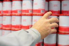 Hand takes jar from  shelf Royalty Free Stock Photo