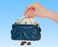 Hand takes out money from  the purse Royalty Free Stock Image