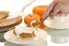Hand takes a piece of pie. Hand takes a piece of pumpkin pie ready to eat it Stock Photography
