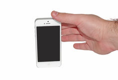 Hand taking Apple iPhone 5 Royalty Free Stock Image
