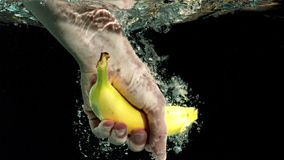 Hand taking a banana from water Royalty Free Stock Photo
