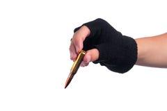 Hand taking bullet Stock Photos