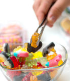 Hand taking candies from jar. detail Stock Photos