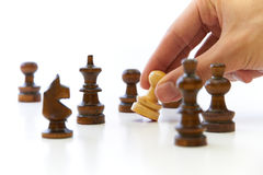 Hand Taking Chess Piece Pawn. On white background Royalty Free Stock Photo