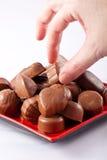 Hand taking chocolate Stock Image