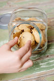 Hand taking a cookie Stock Photos
