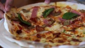 Hand taking crispy pizza slice stock video
