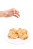 Hand taking croissant. Stock Photo