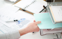 Hand taking documents Royalty Free Stock Images
