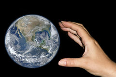 Hand taking the earth Stock Photos