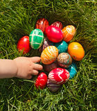 Hand taking Easter egg Royalty Free Stock Image