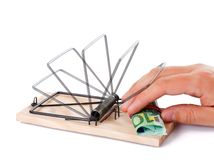 Hand taking money. From the wooden mousetrap Royalty Free Stock Photos