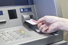 Hand taking money on ATM bank machine Royalty Free Stock Images