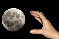 Hand taking the moon Stock Photo