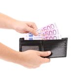 Hand taking out euro bills from purse. Stock Photography