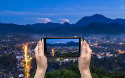 Hand taking photo at viewpoint and landscape in luang prabang Stock Photo