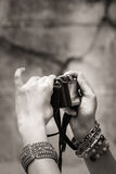 Hand taking picture with camera Royalty Free Stock Image