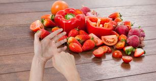 Hand taking picture of fruits and vegetables through device Royalty Free Stock Photos