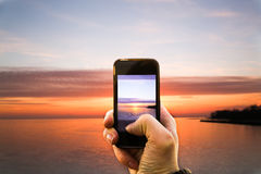 Hand Taking a Picture with a Smartphone Royalty Free Stock Photos