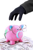 Hand taking piggy bank and money Stock Photos