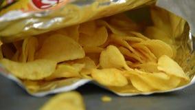 Hand taking potato chips