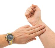 Hand taking pulse Royalty Free Stock Images