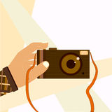 Hand taking selfie shot with retro photo camera Royalty Free Stock Image