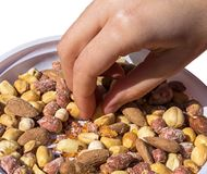 Hand taking some mixed snacks rice crackers, nuts and dried fruits stock photography