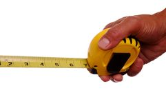 Hand and Tape Measure Stock Photo