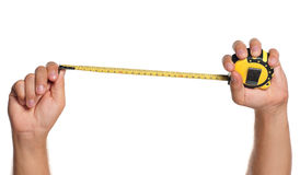 Hand with tape measure Stock Photos
