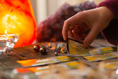 Hand with tarot card. Fortune teller holding tarot card stock photography