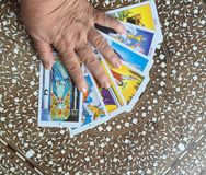 Hand on Tarot Cards. Fortune tellers hands over tarot cards Stock Images