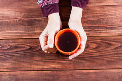 Hand with tea. Royalty Free Stock Photos