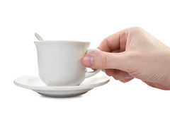 Hand and teacup with plate Stock Images