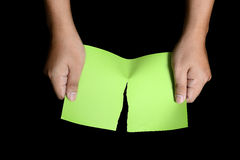 Hand Tearing Green Paper Stock Photo