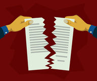 Hand tearing paper documents into two Royalty Free Stock Images