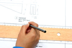 Hand with technical drawing. And tools Stock Photography