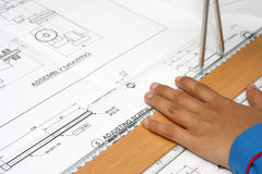 Hand with technical drawing. And tools Stock Photos