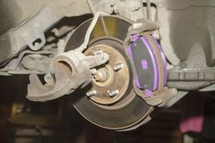 A hand technical specialist repairing the brake system of the modern car.  royalty free stock images