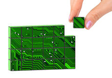 Hand and technology puzzle Stock Images