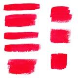 Hand-teckning röda texturer av borsteslaglängder i slumpmässig form Royaltyfri Bild