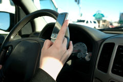 Hand of a teen texting while Royalty Free Stock Image