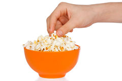 Hand a teenager with popcorn Stock Photography