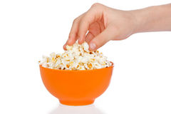 Hand a teenager with popcorn Royalty Free Stock Photo