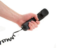 Hand with a telephone Stock Photography