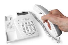 Hand and telephone Stock Photo