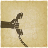 Hand with telephone handset Stock Image