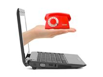 Hand with telephone and notebook Royalty Free Stock Photography