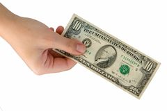 Hand with ten dollars. Female hand with ten dollars on a white background Stock Images